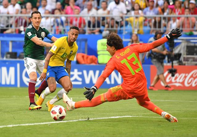 <p>Neymar Jr of Brazil passes the ball to Roberto Firmino of Brazil for Brazil's second goal during the 2018 FIFA World Cup Russia Round of 16 match between Brazil and Mexico at Samara Arena on July 2, 2018 in Samara, Russia. (Photo by Dan Mullan/Getty Images) </p>