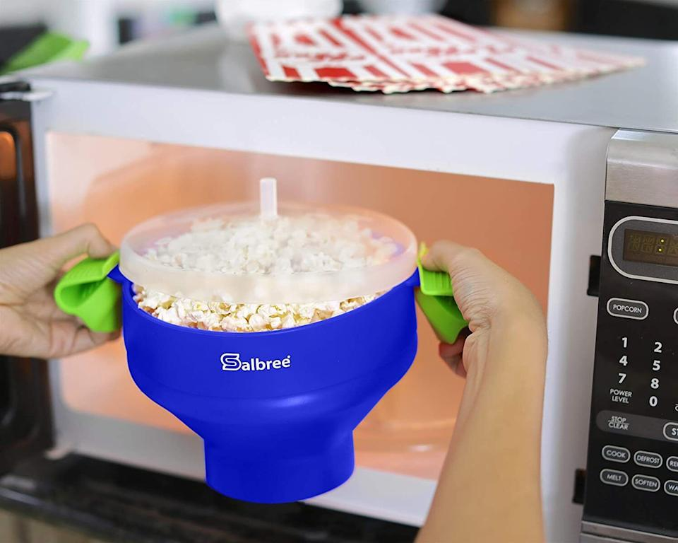 """It'll makemake whipping up a delicious snack super quick and easy. Once it's all popped, you can add butter, oil and seasonings of your choice!<br /><br /><strong>Promising review:</strong>""""My favorite way to make popcorn! Just put the kernels in (nothing else), and put the lid on the bowl — it traps the heat and steam and rises up as the popcorn pops. Then, microwave a few minutes. I pour the popcorn into a big bowl and toss around with butter and salt. I wouldn't put butter or oil in this Salbree bowl or the silicone will get gunky/sticky. Then, just rinse clean. So easy and tastes way better than bagged popcorn! I even bought one for my mom as a gift and she loves hers, too."""" — <a href=""""https://www.amazon.com/gp/customer-reviews/R1TOBVOWBG562S?&linkCode=ll2&tag=huffpost-bfsyndication-20&linkId=4e3ebc2a870961d5d57edd6f88256b8a&language=en_US&ref_=as_li_ss_tl"""" target=""""_blank"""" rel=""""noopener noreferrer"""">Sarah Daniels</a><br /><br /><strong><a href=""""https://www.amazon.com/Original-Salbree-Microwave-Silicone-Collapsible/dp/B01G7SGOL2?&linkCode=ll1&tag=huffpost-bfsyndication-20&linkId=a87d7850ed66a109967b7bcebf004af8&language=en_US&ref_=as_li_ss_tl"""" target=""""_blank"""" rel=""""noopener noreferrer"""">Get it from Amazon for $15.90(available in 23 colors).</a></strong>"""