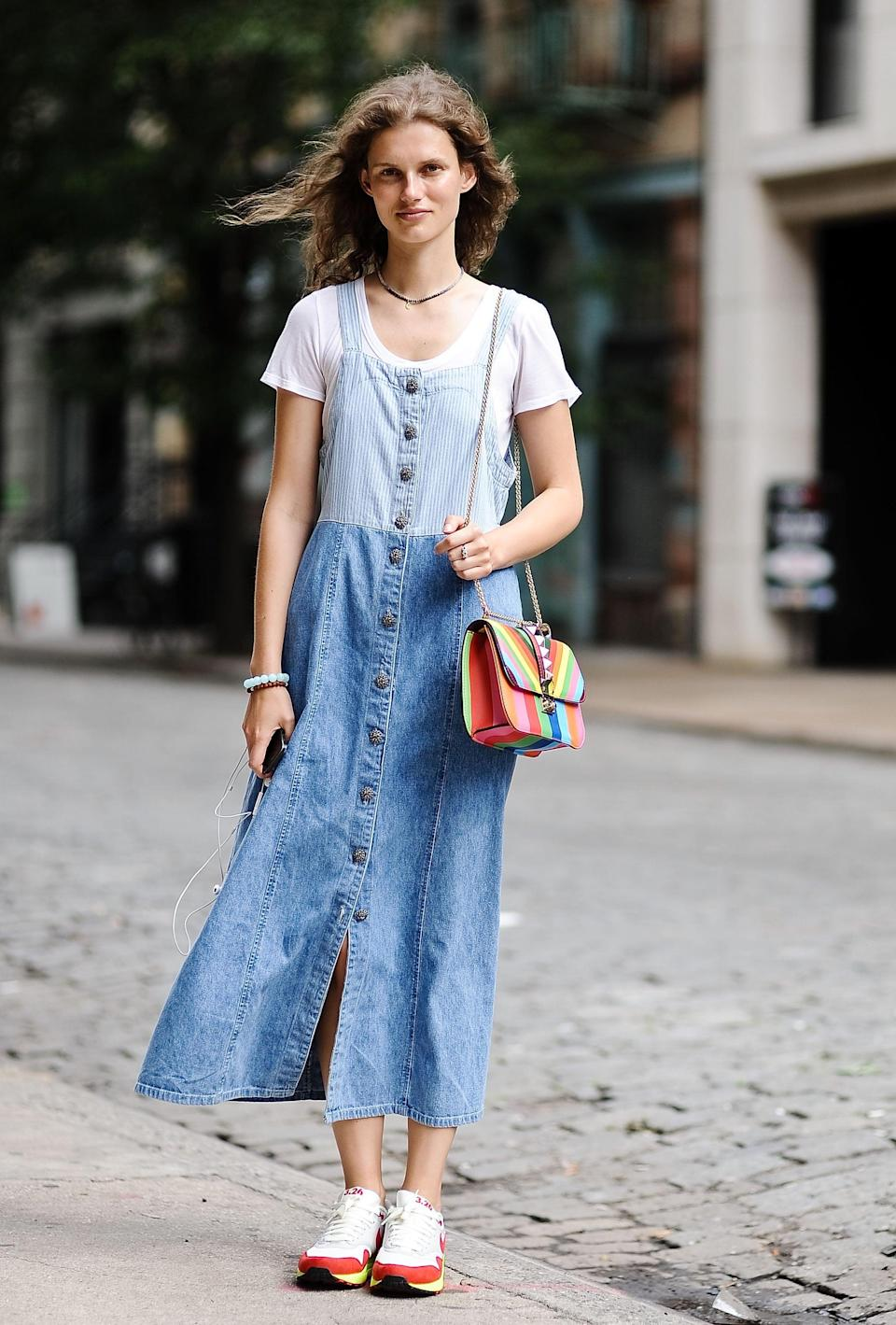 <p>Wearing head-to-toe denim looks extra cool when paired with colorful accessories.</p>