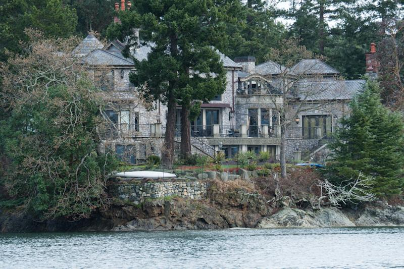 TOPSHOT - The residence of Prince Harry and and his wife Meghan is seen in Deep Cove Neighborhood from a boat on the Saanich Inlet, North Saanich, British Columbia on January 21, 2020. - The new neighbors have been spotted out hiking and down at the farmers' market, but residents of North Saanich say they will ensure privacy for Harry and Meghan at their Canadian island hideaway. The Duke and Duchess of Sussex, along with their baby son Archie, are living at the scenic, wooded property of Mille Fleurs on Vancouver Island after exiting from their royal roles. (Photo by Mark GOODNOW / AFP) (Photo by MARK GOODNOW/AFP via Getty Images)