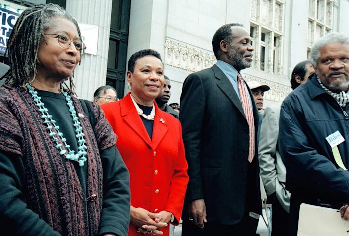 "Rep. Barbara Lee, second from left, was flanked by author Alice Walker, actor Danny Glover, and author Ishmael Reed at a ""Thank You, Barbara"" rally at Oakland's Frank H. Ogawa Plaza Sunday afternoon. Lee made a surprise appearance at the rally held by about 1,500 people in thanks for her ""No"" vote; hers was the only Congressional vote in 421 against using armed forces in retaliation for the Sept. 11 terrorist attacks. (Photo: D. Ross Cameron/MediaNews Group/Oakland Tribune via Getty Images)"