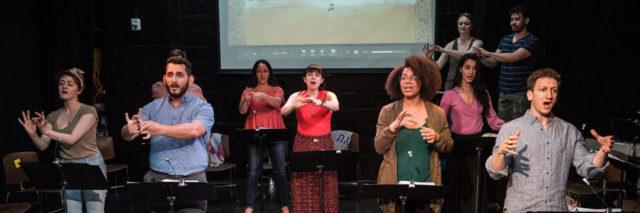 """The Deaf and hearing cast of the musical """"Stepchild"""" perform at IRT Theater. The musical combines singing, music and American Sign Language."""