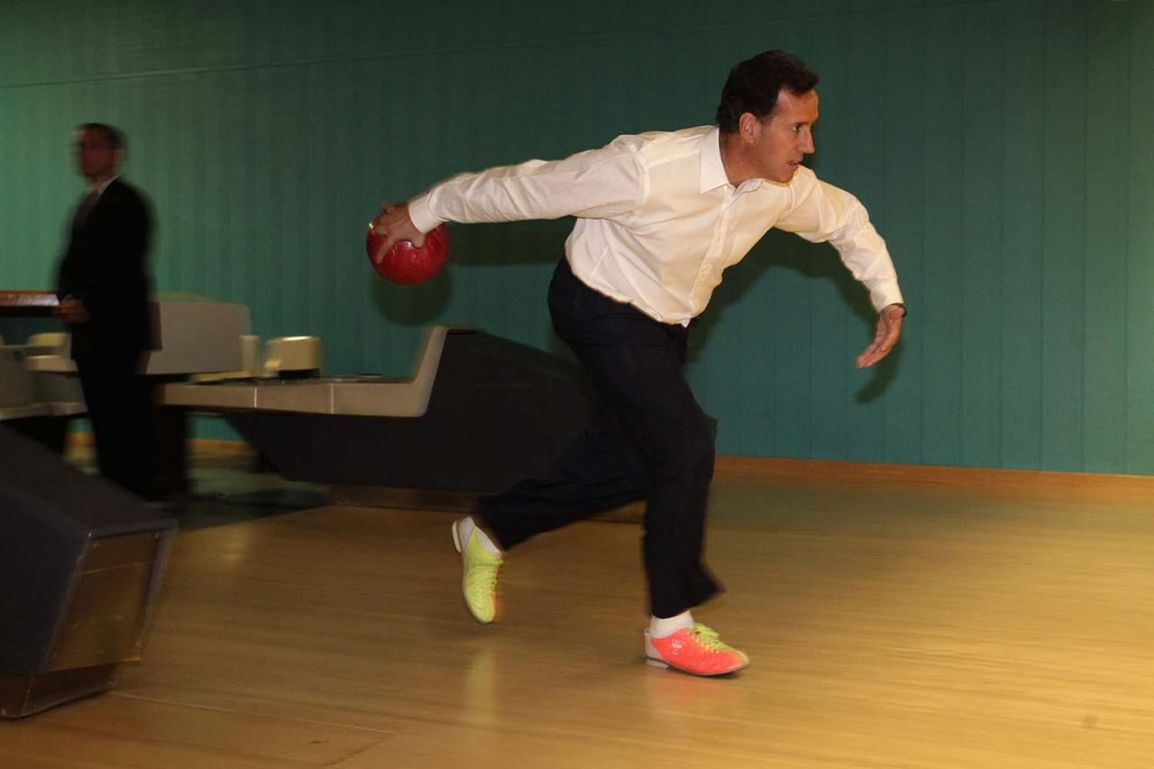 Republican presidential candidate, former Pennsylvania Sen. Rick Santorum bowls in Platteville, Wis., Saturday, March 31, 2012. (AP Photo/Jae C. Hong)