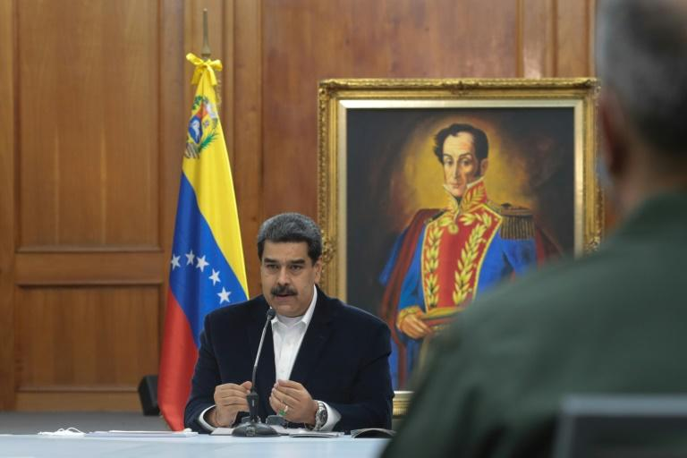 """Venezuela's President Nicolas Maduro meeting with members of the military in Caracas on May 4, 2020 after an alleged """"invasion"""" by  mercenaries"""
