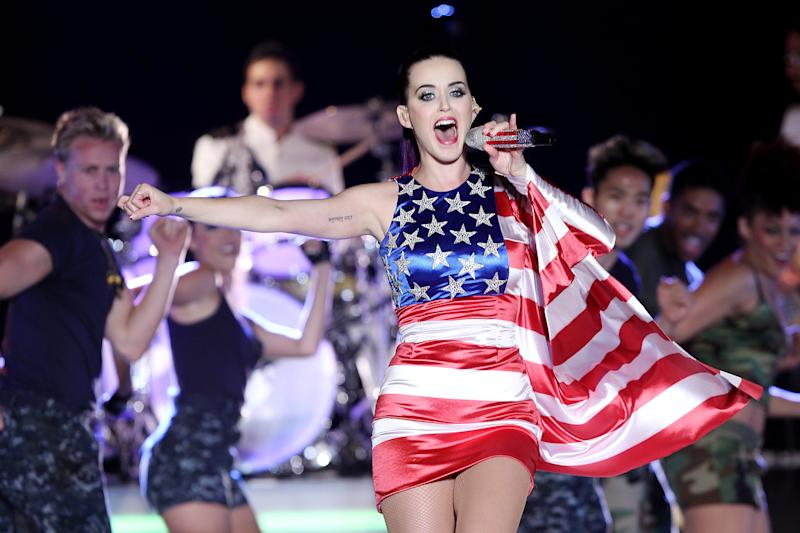 """FILE - In this May 23, 2012 file photo released by Starpix, singer Katy Perry wears a patriotic dress as she performs at a Pepsi-sponsored event at Brooklyn Pier 9A, kicking off Fleet Week in New York. The pop star's energetic Day-Glo performances and chart success _ tying Michael Jackson's """"Bad"""" with five No. 1 singles from her album """"Teenage Dream"""" _ are undercut by heartbreak in her new 3D concert film """"Katy Perry: Part of Me."""" She sobs uncontrollably backstage as her marriage to Russell Brand falls apart during her world tour, and talks about her dashed desire for """"fairy tale"""" romance. The film opens nationwide on July 5. (AP Photo/Starpix, Amanda Schwab, file)"""