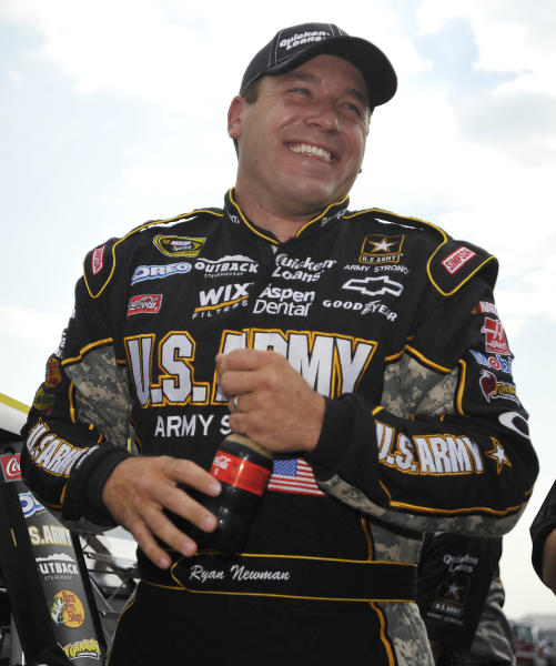 NASCAR driver Ryan Newman is all smiles after his qualifying attempt at the Talladega Superspeedway in Talladega, Ala., Saturday, Oct. 6, 2012. The drivers were qualifying for the Sunday running of the NASCAR Sprint Cup Series auto race. (AP Photo/Rainier Ehrhardt)