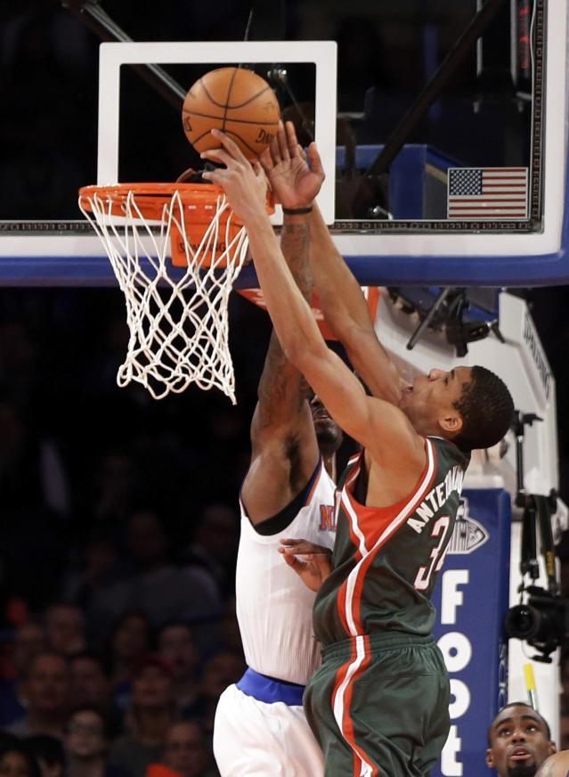 New York Knicks' Amare Stoudemire, left, blocks a shot by Milwaukee Bucks' Giannis Antetokounmpo during the second quarter of an NBA basketball game at New York's Madison Square Garden, Saturday, March 15, 2014. (AP Photo/Richard Drew)