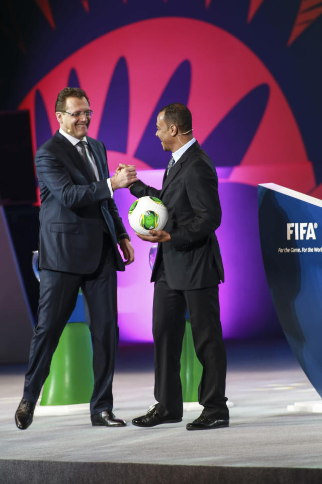 SAO PAULO, BRAZIL - DECEMBER 01: Cafu, Brazilian soccer player and Jerome Valcke present the ball ?Cafusa? during the Draw for the FIFA Confederations Cup 2013 at Anhembi Convention Center on December 01, 2012 in Sao Paulo, Brazil. (Photo by Alexandre Schneider/LatinContent/Getty Images)