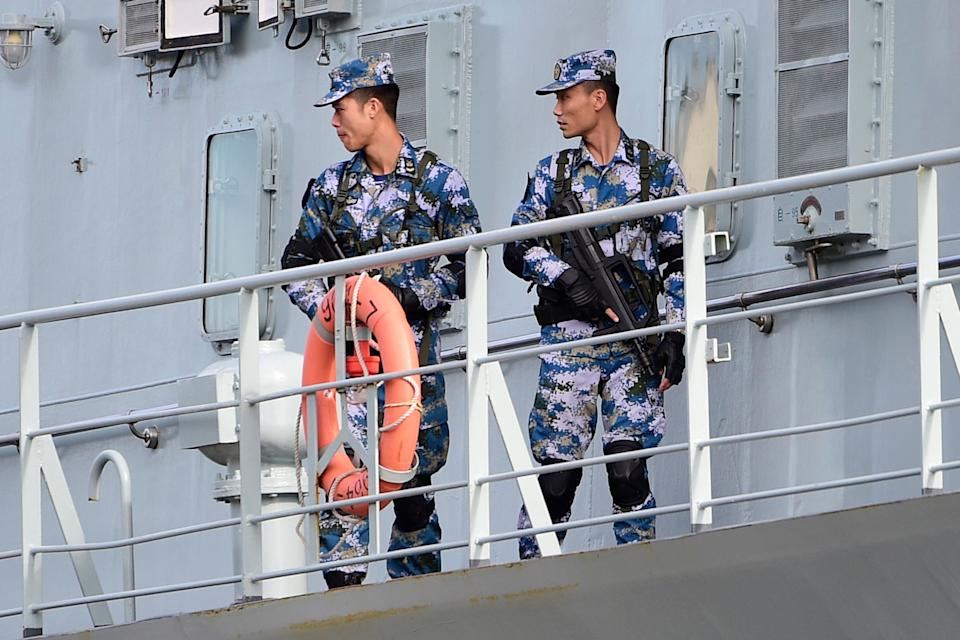 Chinese Navy personnel onboard a Chinese Navel ship after it arrived at Garden Island Naval Base on Monday. Source: AAP