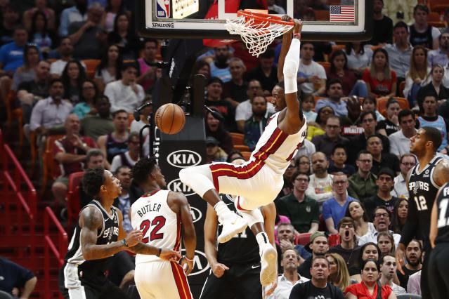 Miami Heat center Bam Adebayo (13) dunks the ball against the San Antonio Spurs in the first half of an NBA basketball game Wednesday, Jan. 15, 2020, in Miami. (AP Photo/Brynn Anderson)
