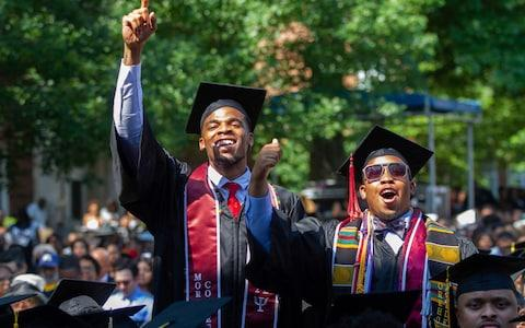 Graduates react to the news that their entire student debt will be wiped out - Credit: Atlanta Journal- Constitution