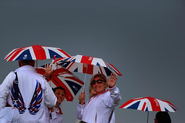 LONDON, ENGLAND - JULY 29: Volunteers hold Union Jack umbrellas in the Olympic Park on Day 2 of the London 2012 Olympic Games on July 29, 2012 in London, England. (Photo by Jeff J Mitchell/Getty Images)