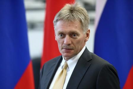 Kremlin spokesman Peskov looks on during a visit to the Mazda Sollers Manufacturing Rus joint venture plant of Sollers and Japanese Mazda in Vladivostok