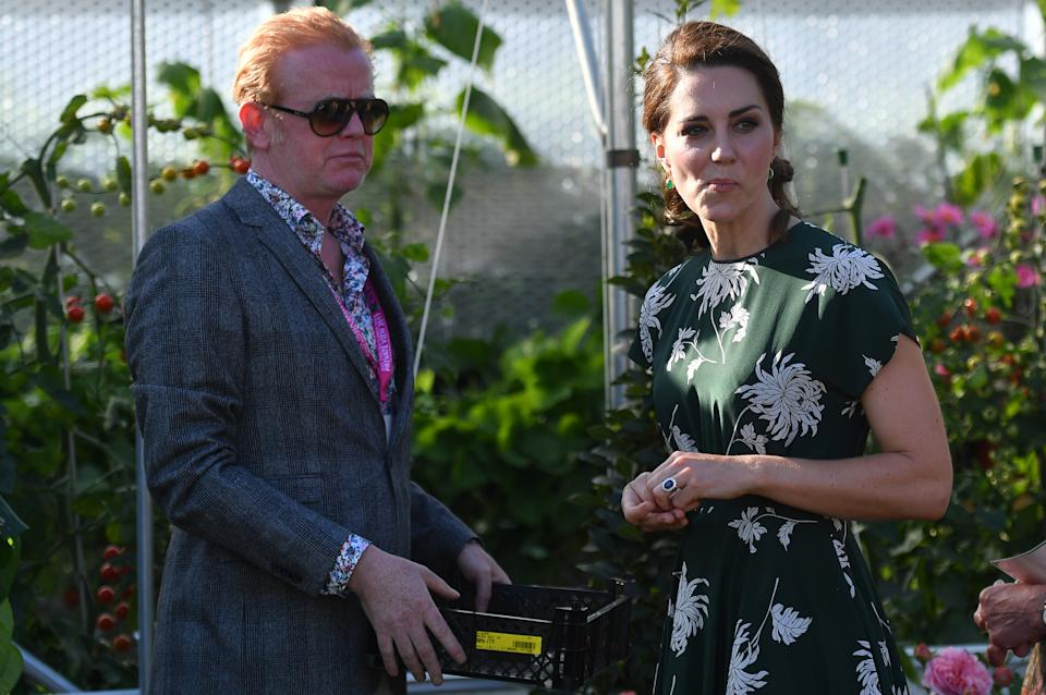 LONDON, ENGLAND - MAY 22:  BBC Radio 2 presenter Chris Evans (L) watches as Catherine, Duchess of Cambridge, samples a tomato at the 'BBC Radio 2: Chris Evans Taste Garden' during her visit the RHS Chelsea Flower Show press day at Royal Hospital Chelsea on May 22, 2017 in London, England. The prestigious Chelsea Flower Show, held annually since 1913 in the Royal Hospital Chelsea grounds, is open to the public from the 23rd to the 27th of May, 2017.  (Photo by Ben Stansall - WPA Pool / Getty Images)