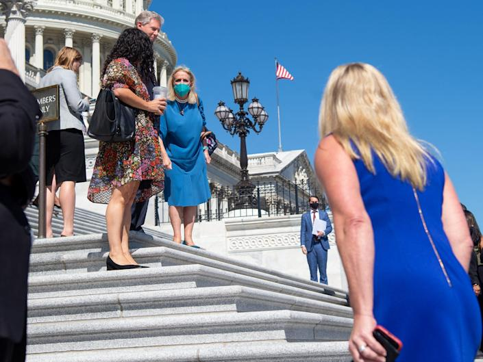 Democratic Rep. Debbie Dingell of Michigan shouts at Republican Rep. Marjorie Taylor Greene as the House Democratic Women's Caucus prepares to hold a press conference promoting the Build Back Better agenda on the steps of the US Capitol in Washington, DC, September 24, 2021.