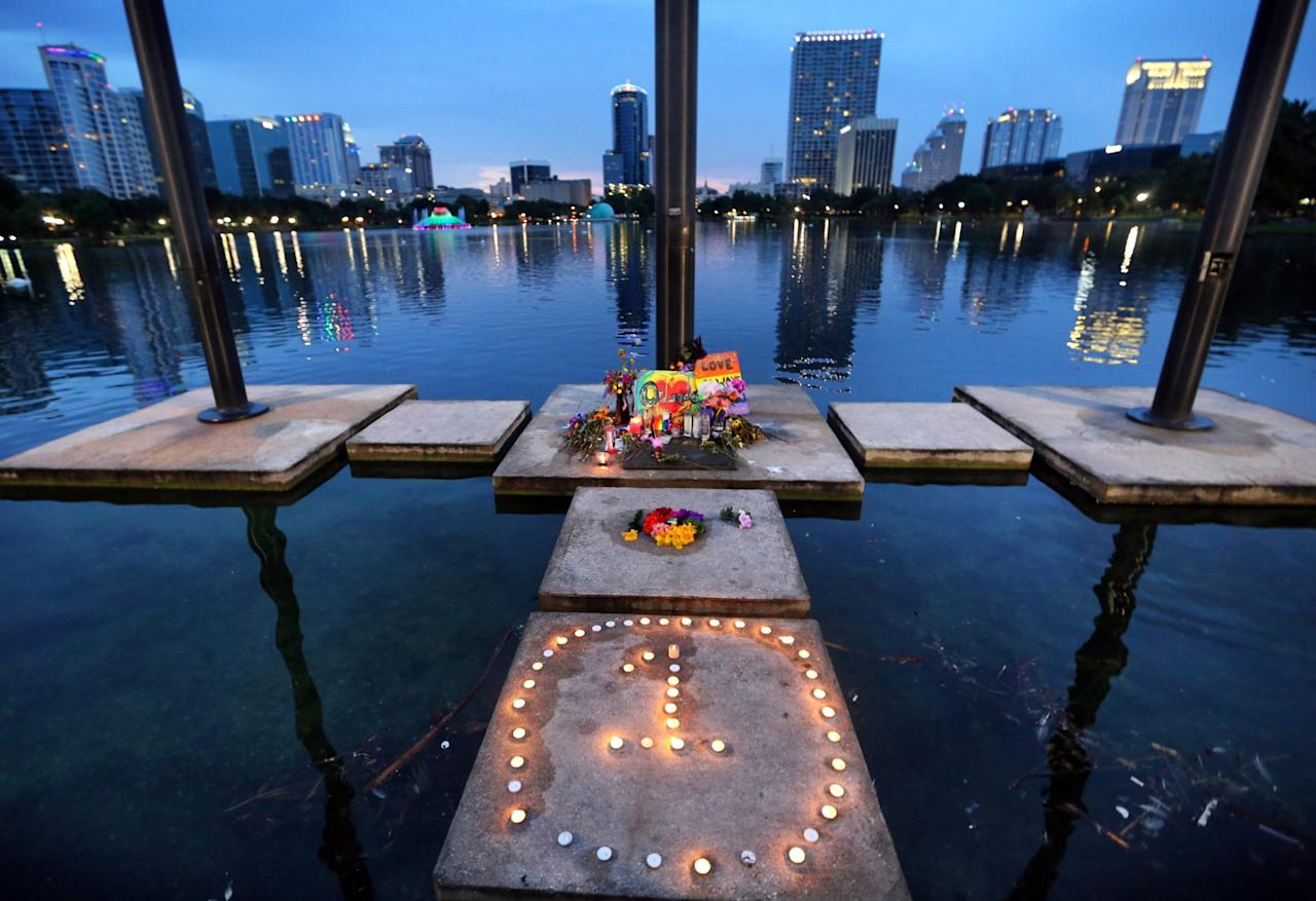 <p>The symbol for 'One Orlando' is spelled out at a makeshift memorial at Lake Eola in downtown Orlando, Fla., Saturday, June 18, 2016. (Joe Burbank(/Orlando Sentinel via AP) </p>