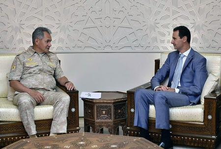 Russian Defence Minister Sergei Shoigu meets with Syrian President Bashar al-Assad in Damascus, Syria September 12, 2017. SANA/Handout via REUTERS