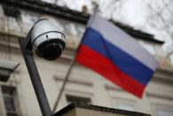 FILE PHOTO: A security camera is seen, and a flag flies outside the consular section of Russia's embassy in London