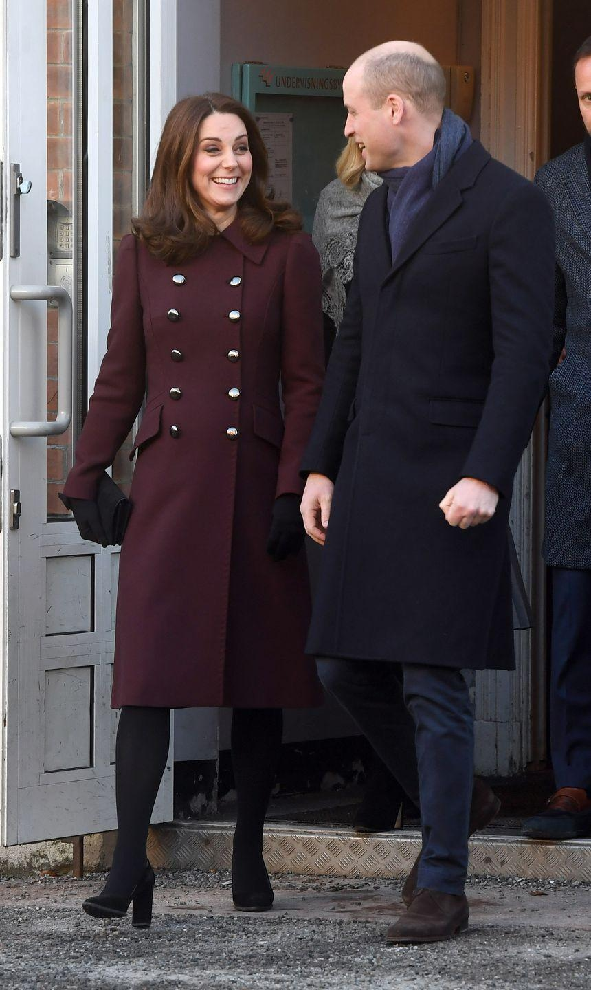 <p>In a maroon double-breasted Dolce & Gabbana coat, black gloves, and a black Mulbury clutch while visiting the Hartvig Nissen School in Norway with Prince William.</p>