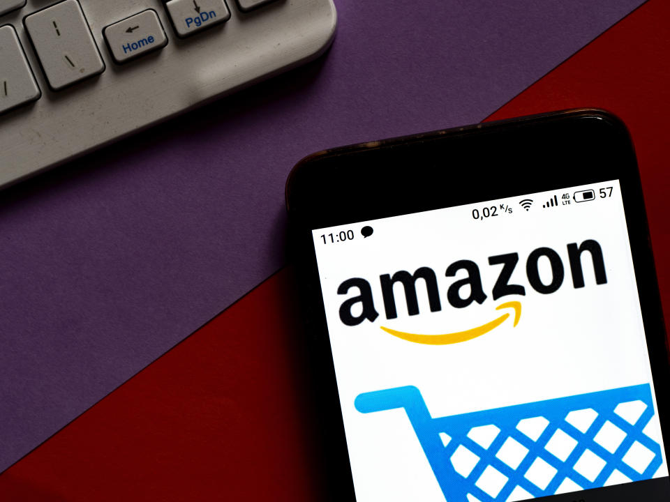UKRAINE - 2020/10/07: In this photo illustration anAmazon Shopping logo is seen displayed on a smartphone. (Photo Illustration by Igor Golovniov/SOPA Images/LightRocket via Getty Images)