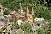 """<p><strong>Population:</strong> 838</p> <p>Located about six hours south of Paris, the department of Aveyron has some of the most beautiful small towns in France. Among these lovely villages is Conques-en-Rouergue (formerly Conques), situated along the Santiago de Compostela pilgrimage route and home to the 12th-century Abbey Church of Sainte-Foy. Make sure to sample the creative gastronomy at Michelin-starred <a href=""""https://www.moulindecambelong.com/en/dining.html"""" rel=""""nofollow noopener"""" target=""""_blank"""" data-ylk=""""slk:La Table d'Hervé Busset"""" class=""""link rapid-noclick-resp"""">La Table d'Hervé Busset</a> when you're in town.</p>"""