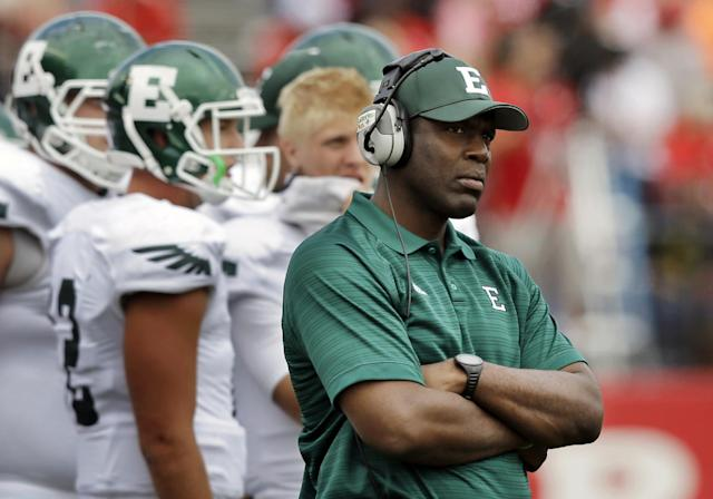 FILE - In this Sept. 14, 2013, file photo, Eastern Michigan head football coach Ron English watches his team during an NCAA college football game against Rutgers in Piscataway, N.J. In a statement Friday, Nov. 8, 2013, athletic director Heather Lyke announced English has been fired. The Eagles, with three games left in the season, are 1-8 entering Saturday's game against Western Michigan.(AP Photo/Mel Evans, File)
