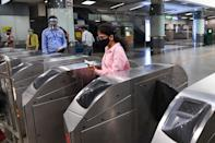 A commuter arrives in a metro station after Delhi Metro Rail Corporation (DMRC) resumed services in New Delhi on September 7, 2020. (Photo by PRAKASH SINGH/AFP via Getty Images)