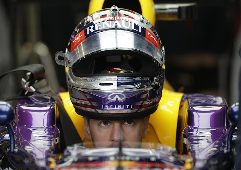 Red Bull driver Sebastian Vettel of Germany sits in his car before the first practice session for the Formula One U.S. Grand Prix auto race at the Circuit of the Americas, Friday, Nov. 15, 2013, in Austin, Texas. (AP Photo/Darron Cummings)