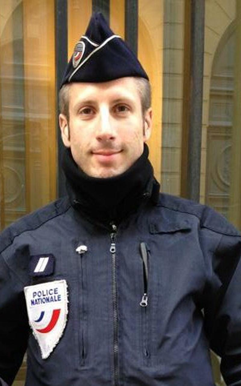 This undated image provided on Friday, April 21, 2017, by FLAG, an association of LGBT police officers, shows French police officer Xavier Jugele - Credit: FLAG via AP