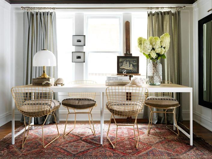 """<p>Combine your dining room and home office with a long modular table that can function as a surface for both eating and working. In this space designed by <a href=""""https://www.housebeautiful.com/design-inspiration/house-tours/g15873332/devin-kirk-house-tour/"""" rel=""""nofollow noopener"""" target=""""_blank"""" data-ylk=""""slk:Devin Kirk"""" class=""""link rapid-noclick-resp"""">Devin Kirk</a>, the chairs are staggered to allow the homeowners to spread out and get down to business at the same time. </p>"""