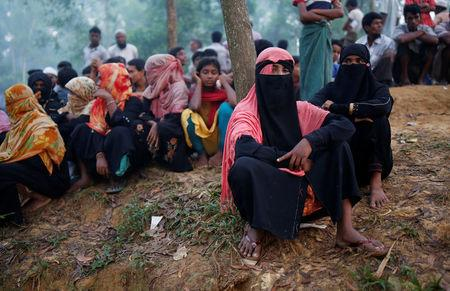 Rohingya refugees wait to receive humanitarian aid at Kutupalong refugee camp near Cox's Bazar
