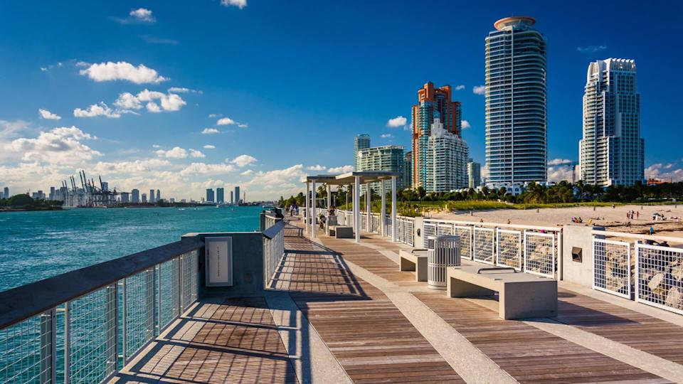 Fishing pier at South Pointe Park and view of skyscrapers in Miami Beach, Florida.