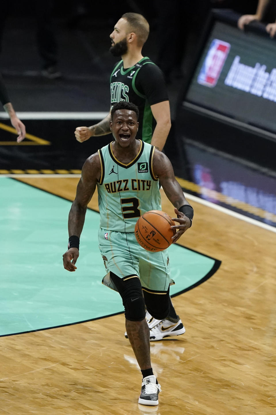 Charlotte Hornets guard Terry Rozier reacts after getting a foul call against the Boston Celtics during the first half of an NBA basketball game on Sunday, April 25, 2021, in Charlotte, N.C. (AP Photo/Chris Carlson)