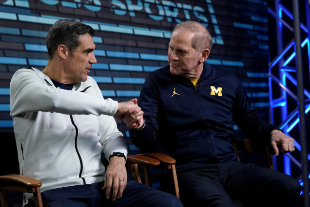 "Villanova head coach Jay Wright, left, and Michigan head coach John Beilein shake hands during an interview for CBS Sports Network's ""We Need to Talk"" show before the championship game of the Final Four NCAA college basketball tournament, Sunday, April 1, 2018, in San Antonio. (AP Photo/David J. Phillip)"