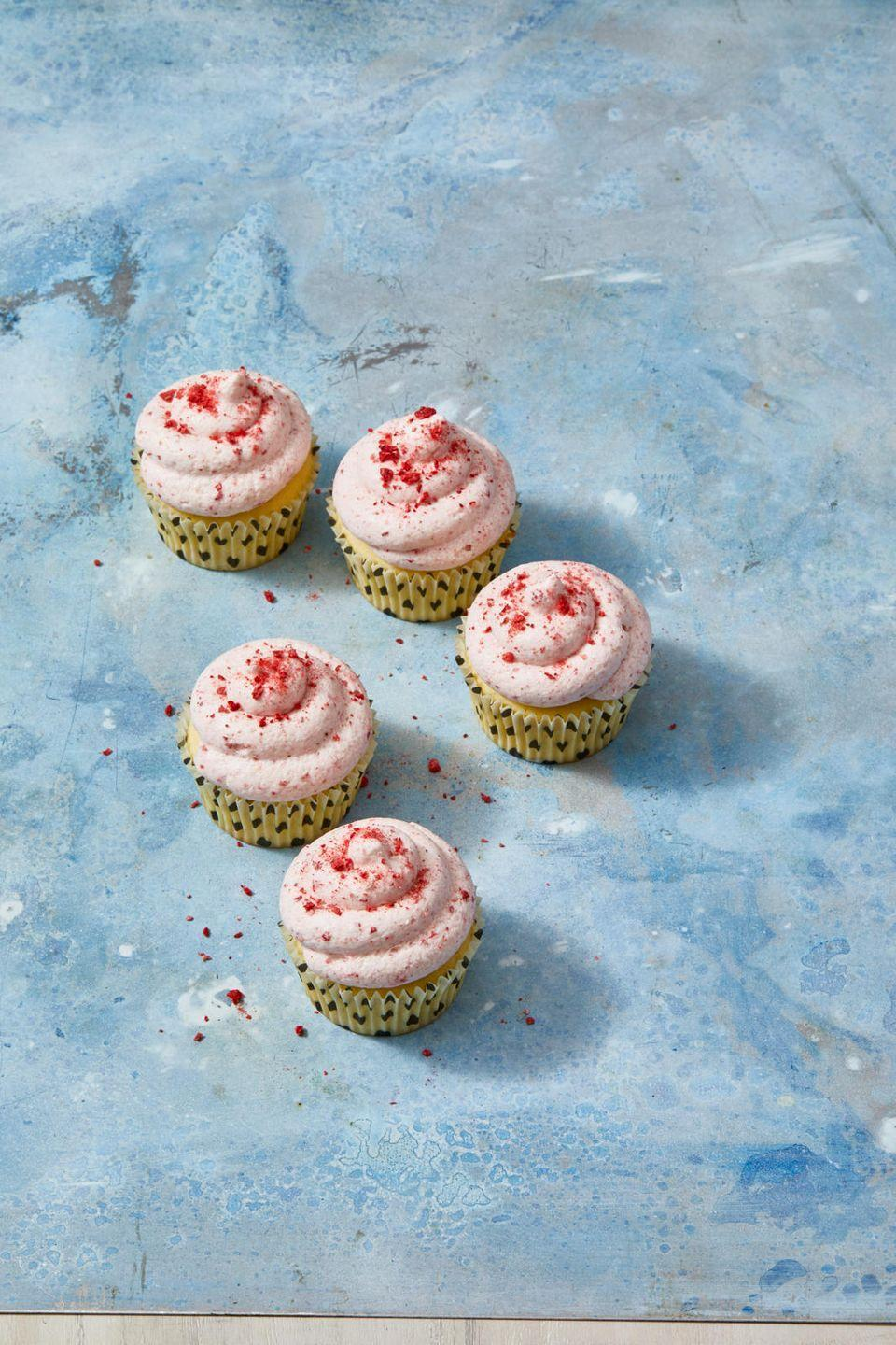 """<p>Add a few extra freeze-dried strawberries to the buttercream frosting to turn it blood-thirsty red.</p><p><em><a href=""""https://www.goodhousekeeping.com/food-recipes/dessert/a31251488/lemon-cupcakes-with-strawberry-frosting-recipe/"""" rel=""""nofollow noopener"""" target=""""_blank"""" data-ylk=""""slk:Get the recipe for Lemon Cupcakes With Strawberry Frosting »"""" class=""""link rapid-noclick-resp"""">Get the recipe for Lemon Cupcakes With Strawberry Frosting »</a></em></p>"""
