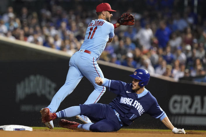 St. Louis Cardinals shortstop Paul DeJong, left, throws out Chicago Cubs' Kris Bryant at first after forcing out Patrick Wisdom during the sixth inning of a baseball game in Chicago, Saturday, June 12, 2021. (AP Photo/Nam Y. Huh)