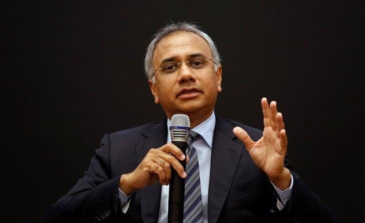 Infosys Chief Executive Officer Salil S. Parekh gestures as addresses the media during the announcement of the company's quarterly results at its headquarters in Bengaluru