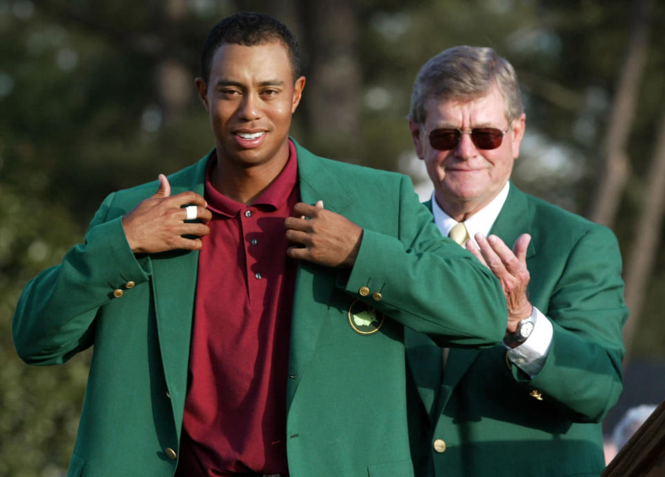 "<p>Tiger Woods, left, adjusts the 2002 Masters Green Jacket he received from Augusta National Golf Club chairman William W.""Hootie"" Johnson, as Johnson applauds at the Augusta National Golf Club in Augusta, Ga. Woods intends to remain out of golf at least until the Masters, two people with knowledge of his plans have told The Associated Press on Thursday, march 11, 2010. The two people, who spoke on condition of anonymity because only Woods is supposed to release such information, say he is likely to play first at Augusta National in April. (AP Photo/Doug Mills, File) </p>"