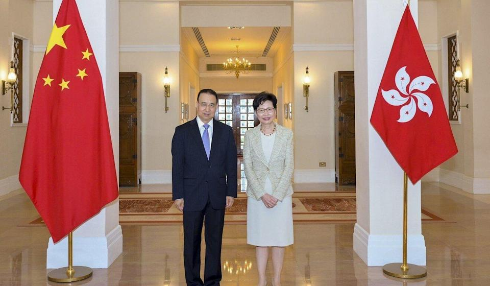 Liu Guangyuan, new head of the Chinese foreign ministry's Hong Kong office, poses with city leader Carrie Lam after their first meeting on Tuesday. Photo: Handout