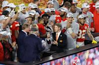 MIAMI, FLORIDA - FEBRUARY 02: Kansas City Chiefs owner and CEO Clark Hunt raises the Vince Lombardi Trophy after they defeated the San Francisco 49ers 31-20 in Super Bowl LIV at Hard Rock Stadium on February 02, 2020 in Miami, Florida. (Photo by Elsa/Getty Images)