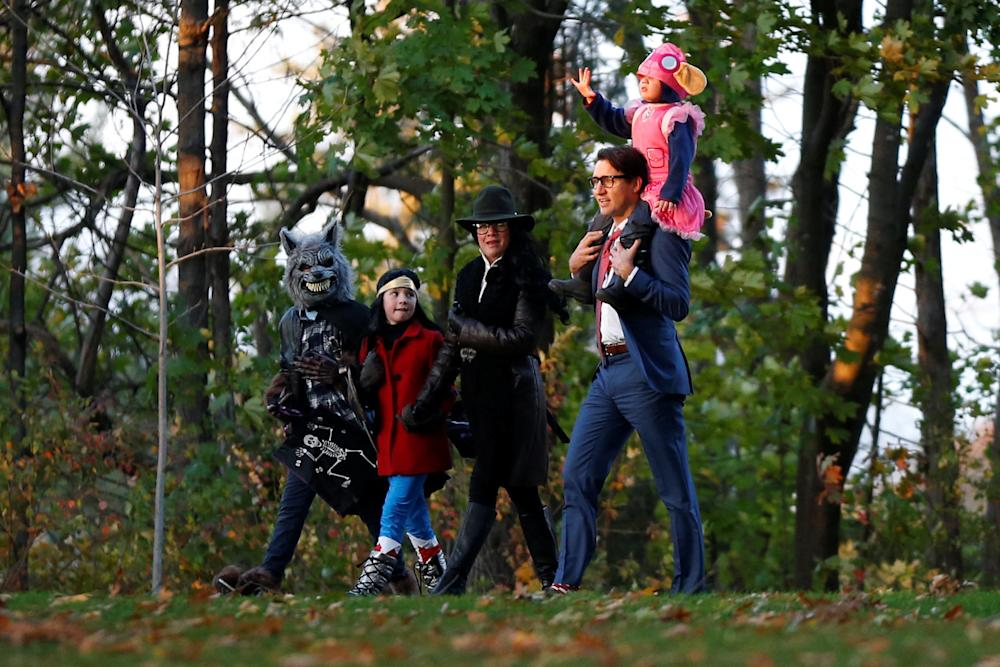 Justin Trudeau walks with his wife, Sophie, and their children as they arrive for Halloween festivities at Rideau Hall.  (Chris Wattie / Reuters)