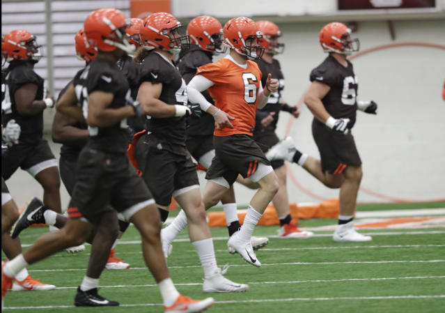 "FILE - In this May 4, 2018, file photo, Cleveland Browns quarterback Baker Mayfield (6) runs a drill during rookie minicamp at the NFL football team's training camp facility in Berea, Ohio. A person familiar with the decision says the Browns will appear on HBO's ""Hard Knocks"" this season. Coming off a historic 0-16 season, the Browns were chosen after declining the opportunity several times, said the person who spoke Thursday, May 17, to The Associated Press on condition of anonymity. (AP Photo/Tony Dejak, File)"