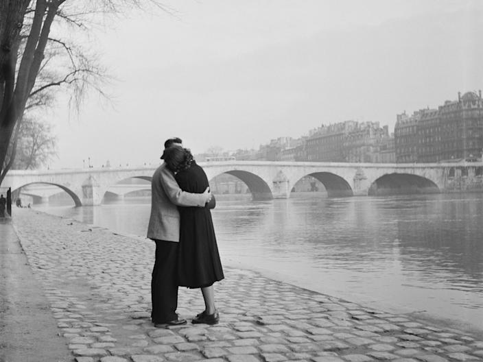 A courting couple on the bank of the Seine, Paris, 1954.