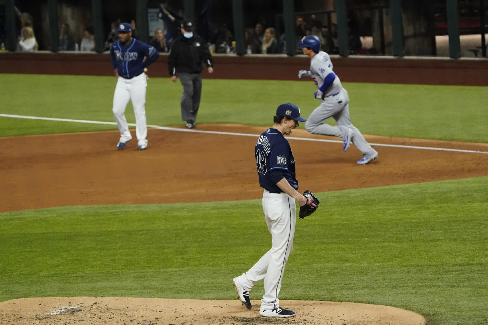 Los Angeles Dodgers' Corey Seager rounds the bases after a home run off Tampa Bay Rays starting pitcher Ryan Yarbrough during the third inning in Game 4 of the baseball World Series Saturday, Oct. 24, 2020, in Arlington, Texas. (AP Photo/Tony Gutierrez)