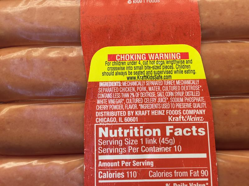 This Wednesday, June 28, 2017, photo, shows the ingredients and nutrition label on a package of Oscar Mayer classic uncured wieners for sale at a grocery store in New York. The label lists cultured celery juice as an ingredient. Oscar Mayer is touting its new hot dog recipe that uses nitrite derived from celery juice instead of artificial sodium nitrite, which is used to preserve the pinkish colors of processed meats and prevents botulism. Kraft Heinz, which owns Oscar Mayer, says sodium nitrite is among the artificial ingredients it has removed from the product to reflect changing consumer preferences. The change comes amid a broader trend of big food makers purging ingredients that people may feel are not natural. (AP Photo/Candice Choi)