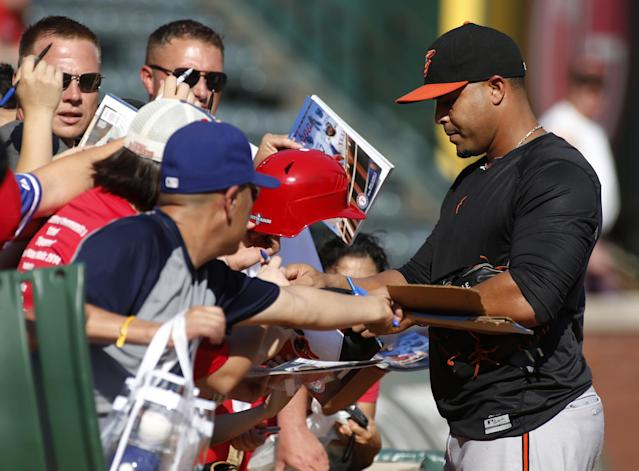 Baltimore Orioles left fielder Nelson Cruz signs autographs for fans before a baseball game against the Texas Rangers on Tuesday, June 3, 2014, in Arlington, Texas. Tuesday was Cruz's first time to play in Arlington after his 50 game suspension last season, when he played for the Rangers. AP Photo/Sharon Ellman)