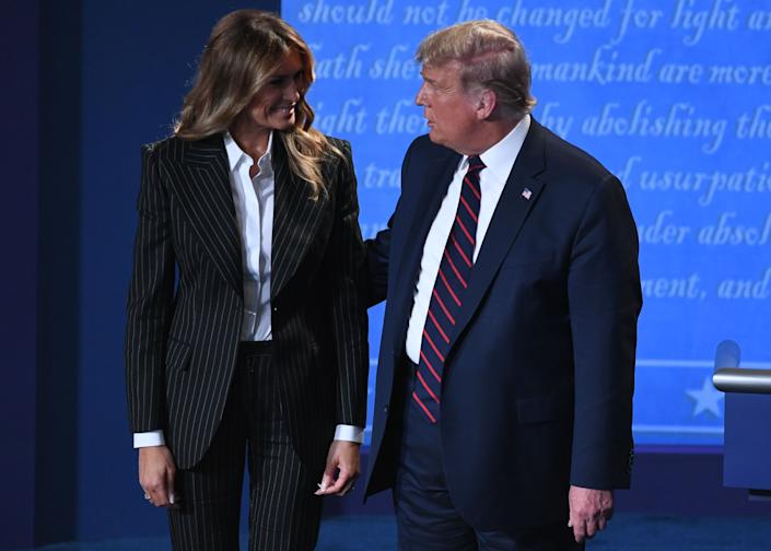 US President Donald Trump and US First Lady Melania Trump leave after the first presidential debate at Case Western Reserve University and Cleveland Clinic in Cleveland, Ohio, on September 29, 2020. (Photo by SAUL LOEB / AFP) (Photo by SAUL LOEB/AFP via Getty Images)