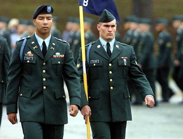 Specialist Pat Tillman, right, a former Arizona Cardinal, walks next to Captain Christoper Deale, company commander of B Company 1st BN 19th Infantry Regiment, during graduation ceremonies on October 25, 2002 at Fort Benning, Georgia. (Mike Haskey/Columbus Ledger-Enquirer)