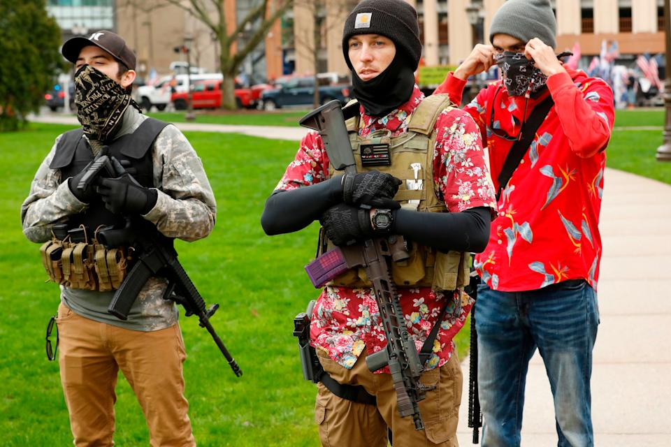 """Heavily armed anti-lockdown protesters began showing up at the Michigan State Capitol in April around the time President Donald Trump tweeted """"LIBERATE MICHIGAN."""" (Photo: JEFF KOWALSKY via Getty Images)"""