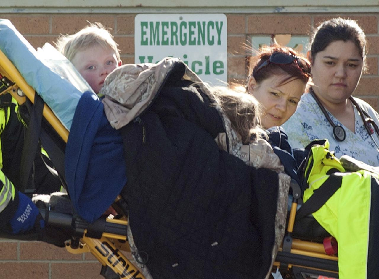 Members of a family that went missing are wheeled by stretcher from an ambulance into the Pershing General Hospital in Lovelock, Nevada, December 10, 2013. A Nevada couple and four young children reported missing on Sunday in a remote mountain range northeast of Reno were found safe by rescue workers on Tuesday huddled in a canyon, a dispatch supervisor for the Pershing County Sheriff's Office said. RECROP OF NV650 REUTERS/James Glover (UNITED STATES - Tags: SOCIETY DISASTER)
